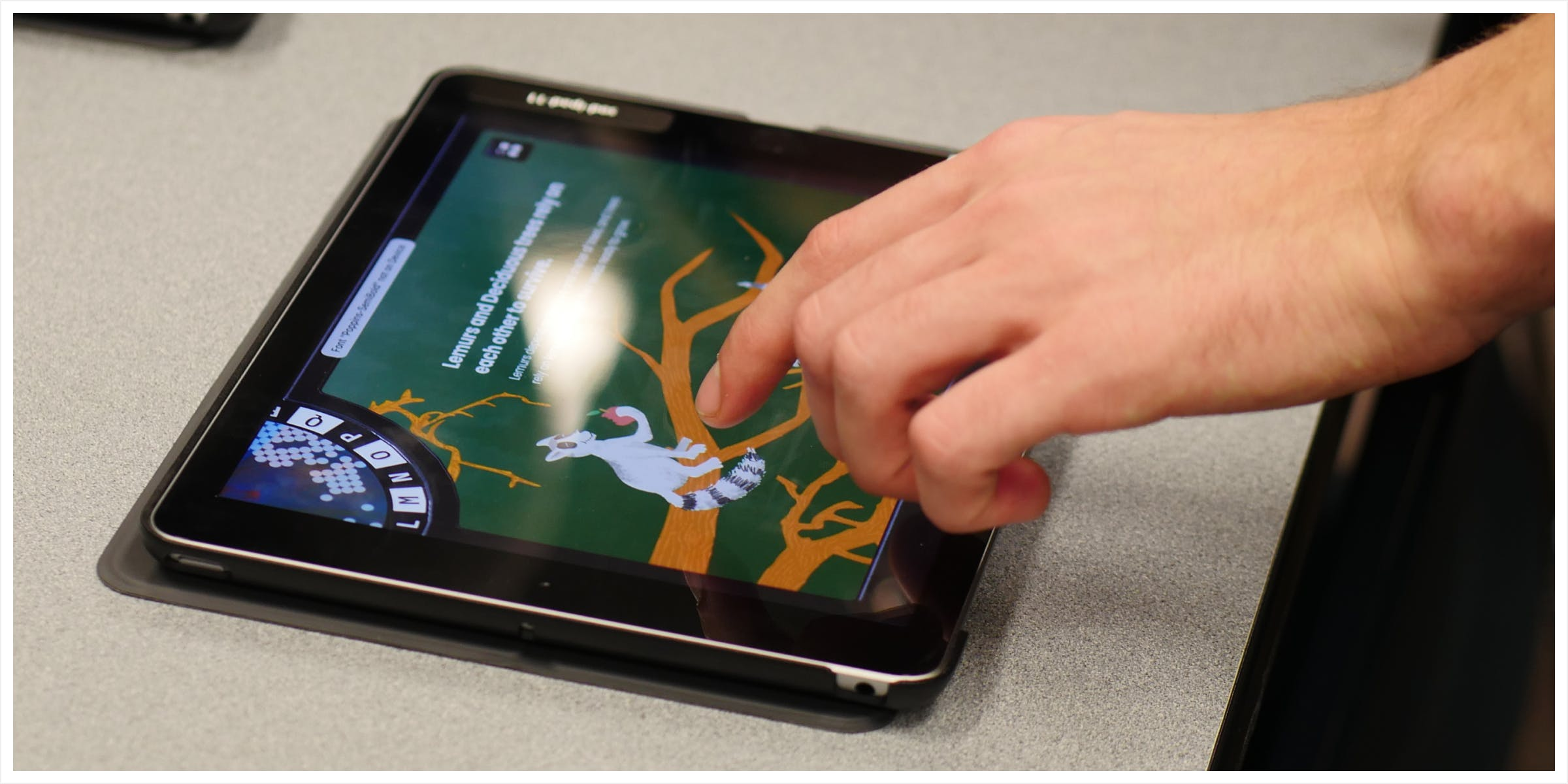 A hand touching an iPad with the interactions